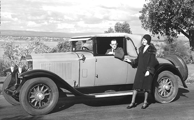 Pic. #6 of 7 (sent by Rick Beazley): This photo was taken for a newspaper article about the newly fitted car radio (big news back then) and shows the original owners.