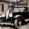 "29-44 - The charming photo taken in Brazil shows us ""Miss JF (after Juiz de Fora"", a city also known as J.F. in the southeastern Brazilian state of Minas Gerais, located close to the state border with Rio de Janeiro). She is posing on top of the rad of a sporty 1929 Buick roadster.  She is wearing a polka-dotted dress, high heels and an attractive hat, all in the fashion of the time.  The Buick is equipped with quite an expensive accessory bumper with driving lights in either end.  The photo is courtesy of Marcelo Lemos via Guilherme de Costa Gomes' site ."
