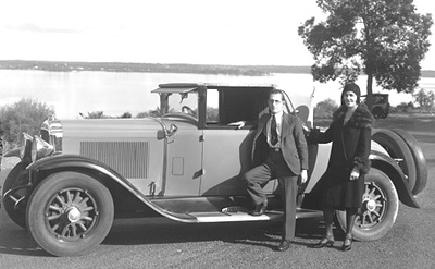 Pic. #7 of 7 (sent by Rick Beazley):  This photo was taken for a newspaper article about the newly fitted car radio (big news back then) and shows the original owners.