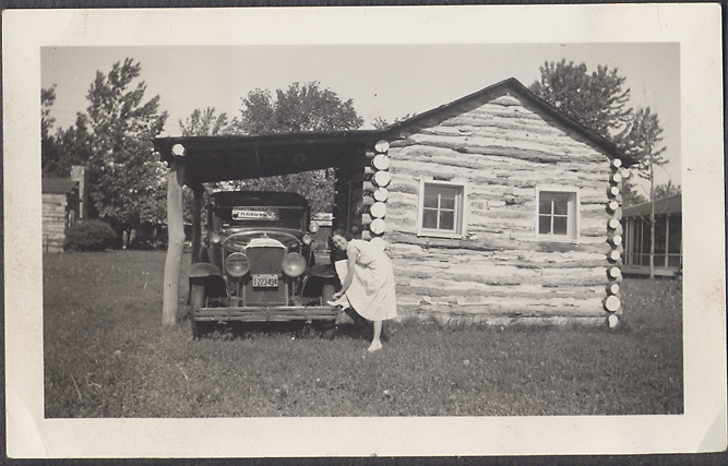 Pretty girl at camping site with 29 Buick sedan