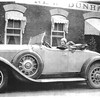 Girl in roadster (29-44) w/artillery wheels at New Dunham Hotel
