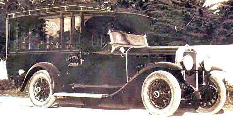 1929 Buick Hearse with early rad cap and, I think, hubcaps.  Lettering seems to be:  F ? Watts, Latri??  Windshield appears to be from an open car - likely a 29-25 touring as there appears to be no rod between front aprons.