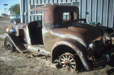 "29-26S:  Described as: ""almost rustfree.  All the metal is there but the wood is gone from sitting outside for years. The only metal-part that I found missing is the windshield-frame.  Only 34,000 miles on it.  Radiator stored and in excellent condition. Could easily be restored to original with a complete wood-kit !""  Sold for $2,605 on eBay (Dec. 2012)"