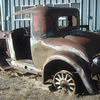 """29-26S:  Described as: """"almost rustfree.  All the metal is there but the wood is gone from sitting outside for years. The only metal-part that I found missing is the windshield-frame.  Only 34,000 miles on it.  Radiator stored and in excellent condition. Could easily be restored to original with a complete wood-kit !""""  Sold for $2,605 on eBay (Dec. 2012)"""