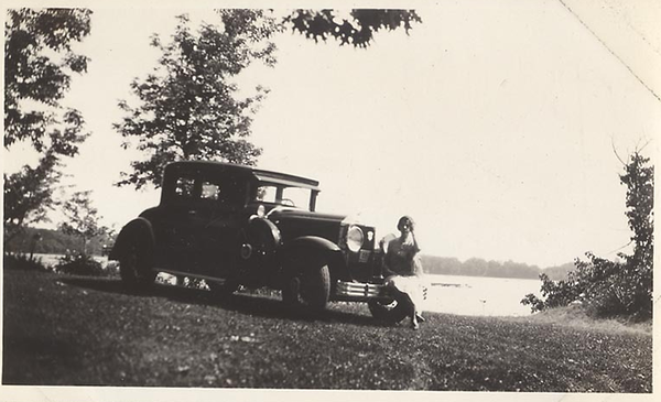 Side-mounted 29 Coupe with gal sitting on front bumper