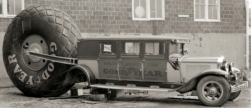1929 Flxible bodied Buick - used by Goodyear to tow the world's largest tire - looks like car has had some rear axle problem
