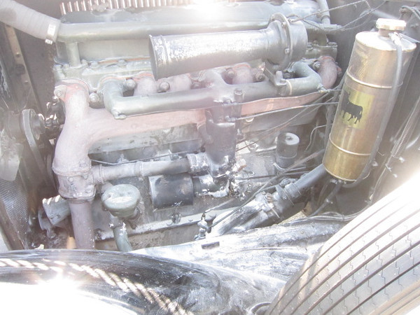 29-44 McLaughlin Buick.  Immediately after carb fire (July 2012).  Note:  top on carb has melted.
