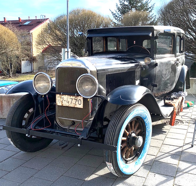 29-7 Seater Sedan.  Owned by P. Lancaster in Finland.  Note: Early radiator cap and hubcaps.  Also, interesting design on headlight glass (see next Photo).