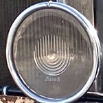 Interesting design on headlight glass on 29-7 Seater Sedan.  Owned by P. Lancaster in Finland.
