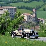 Jan van Gemertdriving his 1929 Buick model 29-44 roadster through the Italian countryside in the 2011 Italian Mille Miglia