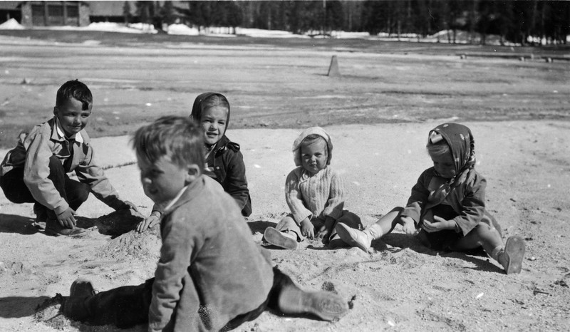 John Reynolds, Jan Ela, Jeanie Reynolds, Mary Ela and Bob Reynolds in the front picnicking somewhere in Yellowstone.