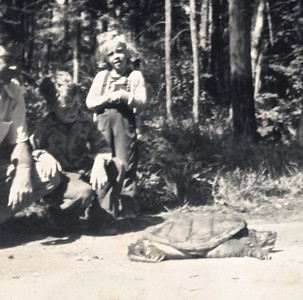 Carol DeWolf (now Helsel) and snapping turtle 1950