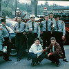Left to right back row.  Joe Prevost, Ray Savelli, Chief Fran Rutty, John Robinson, Ray Walz Jr, Henry Parde.   Kids in front row unknown