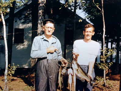 Walter and Charles Bowman with an impressive catch, 1969