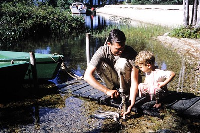 Dan and Steve Leone with fish, 1964