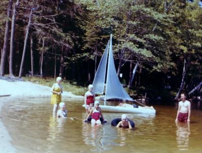 Enjoying the beach , 1962