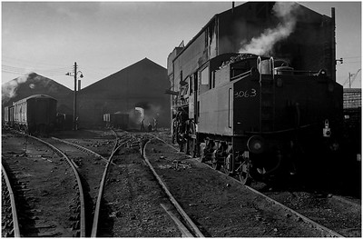 Early morning at North Blyth MPD as LMS 4MT 43063 waits to enter the roundhouse as Jeff Simpson (by the lamp-post) observes the action in the ash pit. We had spent the early part of the night on this locomotive with driver Cyril Lamb(?) working to/from Lynemouth Colliery.