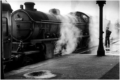 A young fireman has a chat with crew of LNER K1 62050, bound for Alnwick.
