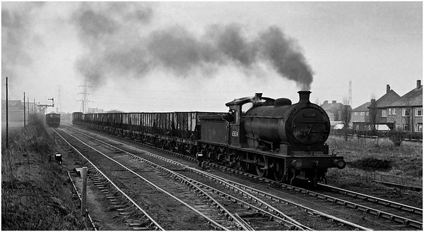 NER J27 65834 on the Blyth and Tyne at Backworth with coal empties.