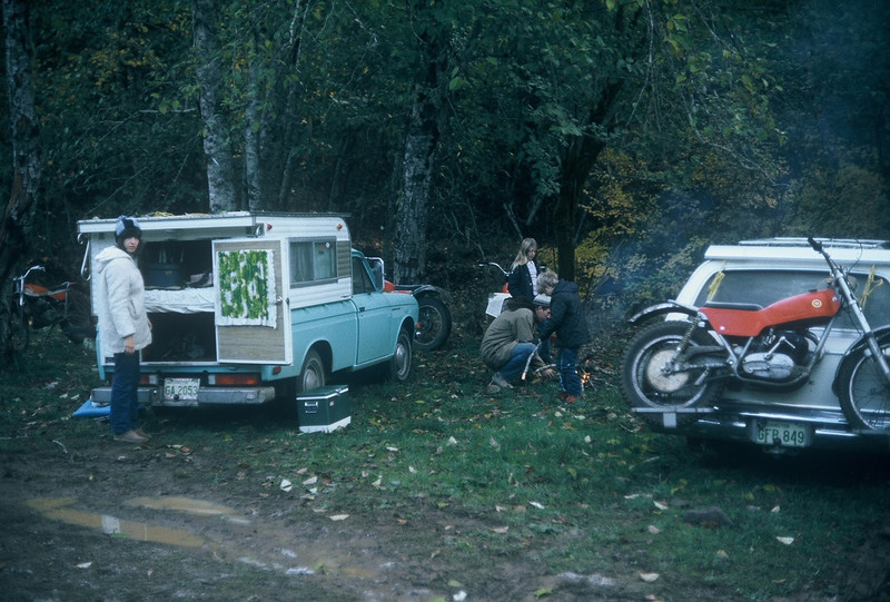 We bought this Datsun pickup for $1995 new and drove it from Jasper BC to San Simion CA. We are camping at a trials event in BC near Ashford. That's Sylvia with the stocking hat and my Sherpa T to the left of her..