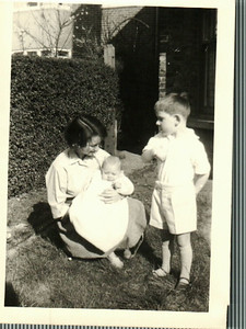 Sheila with Paul and Jean in the front garden in Bexleyheat