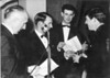 1964<br /> Portsea Presentation Night<br /> L-R<br /> Mil Napthine (President)<br /> Gus Milligan (Club Captain)<br /> Vernon Spencer (Treasurer)<br /> Tony Cushen (Club Champ - Beach Sprint & Musical Flags)