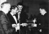 1964 <br /> Portsea Presentation Night<br /> L-R<br /> Mil Napthine (President)<br /> Gus Milligan (Club Captain)<br /> Vernon Spencer (Treasurer)<br /> Nick Thom (Winner - John Wishart Memorial Trophy)