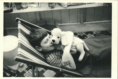 Paul in the conservatory in Pagham with Jean's dog