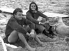 """1965-66<br /> Portsea Back Beach<br /> L-R<br /> Graham Wells<br /> Sally Bell (nee Tait) Rod's girlfriend<br /> Simba (Rod's dog)<br /> Rod's 9' 10"""" Max Gill semi gun triple stringer (this was No 17 Max Gill when he joined Tony Olsen at the Melbourne Surf Shop 106-108 Clarendon St South Melbourne) Surf board was stolen from Clubhouse in 1968-69"""