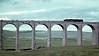 70xxx, Ribblehead, June 1967.  An unidentified Britannia drifts over the viaduct towards Settle.