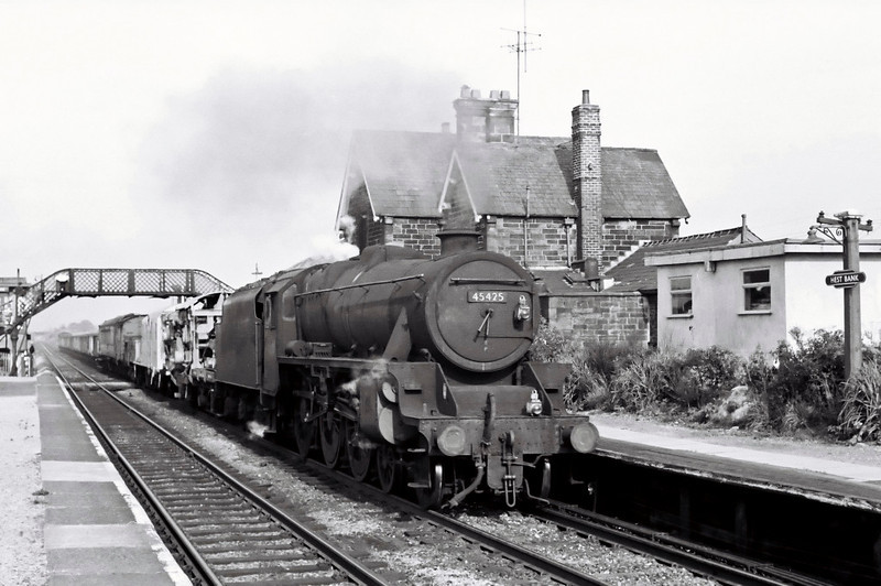 45425, Hest Bank, August 1967.    A southbound freight wheels through the station.  The Black 5 was withdrawn two months later.