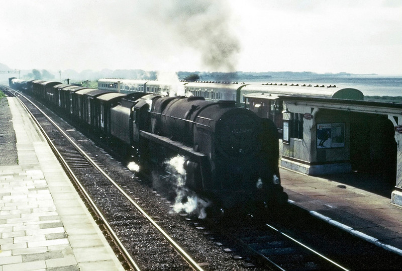 92212, Hest Bank, August 1967.  A northbound freight passes the five camping carriages, a Hest Bank feature for many years. The 9F was withdrawn in January 1968 and is preserved.