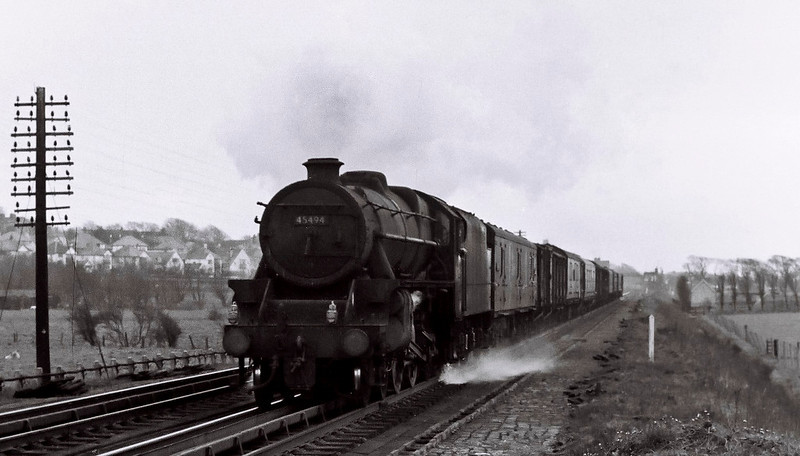 45494, Hest Bank, 25 March 1967.    The Black 5 picks up water as it takes a parcels train north.  It lasted until September.