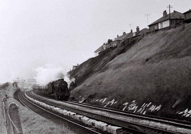 8F, Hest Bank, 25 March 1967.    A freight heads south past the  embankment, then well-tended in stark contrast with the scene today.