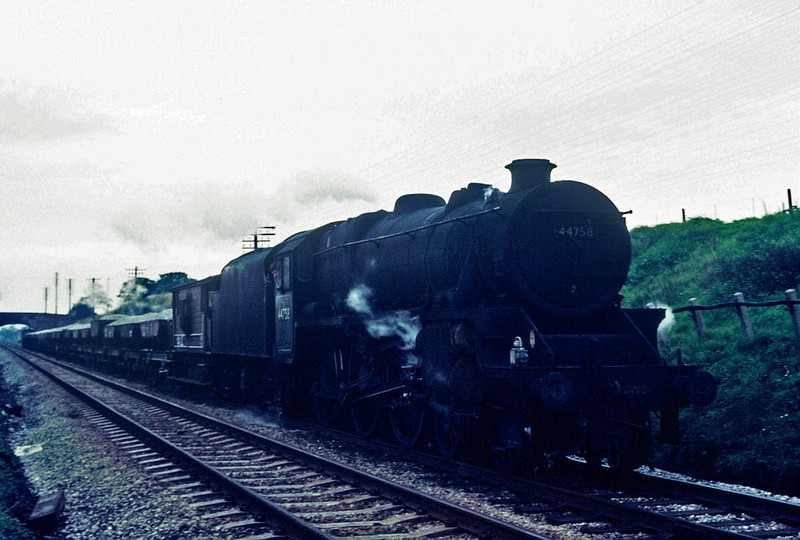 44758, Bolton-le-Sands, August 1967.  A ballast train heads south towards the troughs.  The Black 5 was withdrawn in July 1968.