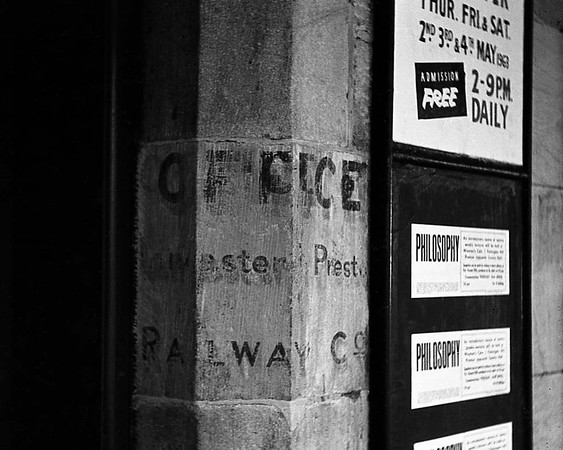 Lancaster & Preston Railway office sign, Lancaster Castle station, 27 April 1963.  The Lancaster & Preston Junction Railway opened  in 1840 from Preston to a station near Penny Street, in the Greaves area of southern Lancaster.  The Lancaster & Carlisle Railway opened Castle station in 1846.  LPJR trains began using it from 1849.  The LPJR and L & C merged in 1859 and were immediately leased by the London & North Western Railway. The sign seen here was on platform 3.  It must have dated from 1849 - 1859, but was lost when the station stonework was cleaned in the 1970s.  Photo by Ron Herbert.