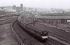 Diverted DMU train, approaching Whitehall Junction, Leeds, Sat 29 April 1967.  This train is heading away from the camera to City station.  It would have used Central station until its closure,  At right is the Leeds & Thirsk Railway roundhouse, built in 1850.  It is listed Grade 2, and n 2017 survives in commercial use after restoration.