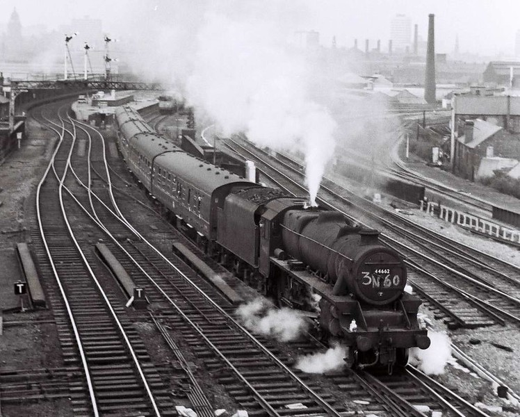 44662, Holbeck High Level, Sat 29 April 1967 1.  The class 1 headlamps and people leaning out of the windows shows that this train cannot be a 3N60 empty stock working.  44662 had derailed at Wennington on 16 February 1967 when working the 1815 Hunslet - Carnforth loaded coal.  It was unable to stop in the down loop, became derailed at the trap point and ran onto the westbound platform.  The tender was detached and two breakdown cranes were used to recover the.loco.