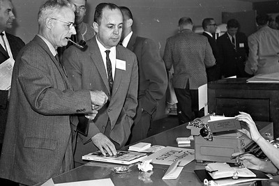 Two delegates registered for the Redwood Region Logging Conference in March 1962 at Redwood Acres in Eureka. They are W.F. Mann of Willits, left, and Joe Springer of the State Division of Forestry, from Fortuna. (Times-Standard file photo)