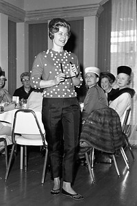 A fashion show took place during the Ladies Luncheon  at the Redwood Region Logging Conference. Pictured is model Mrs. Melvin Bode, showing clothes from the JJ Shop. (Times-Standard file photo)