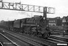 19630808-007  BR standard 4MT 2-6-0 No. 76058 passing through Eastleigh with a goods train.