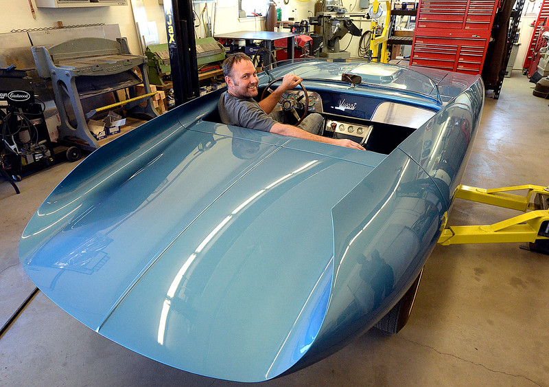 Jake Yenny, owner of JEM Motorworks, poses for a photo sitting behind the wheel of a 1965 Vivant on Wednesday, Oct. 18, 2017, at his Loveland shop. Yenny spent a year and a half totally remaking a 1965 Vivant, a one-of-a-kind concept car that was created by a man who went on to spend his career designing things for Pontiac. The rebuilt Vivant won first place in its class this summer at the Pebble Beach Concours d'Elegance, which is considered the top car show in the world.   (Photo by Jenny Sparks/Loveland Reporter-Herald)
