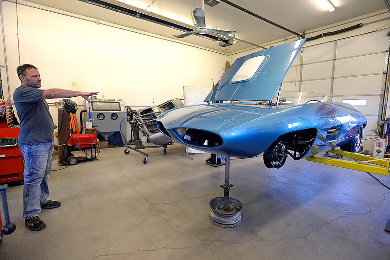 Jake Yenny, owner of JEM Motorworks, talks about the work he did on a 1965 Vivant on Wednesday, Oct. 18, 2017, at his Loveland shop. Yenny spent a year and a half totally remaking a 1965 Vivant, a one-of-a-kind concept car that was created by a man who went on to spend his career designing things for Pontiac. The rebuilt Vivant won first place in its class this summer at the Pebble Beach Concours d'Elegance, which is considered the top car show in the world.   (Photo by Jenny Sparks/Loveland Reporter-Herald)