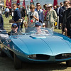 Loveland resident Jake Yenny sits in the passenger seat of the 1965 Vivant concept car that he restored. The roadster's owner, Dr. Mark Brinker, sits behind the wheel in this Aug. 20, 2017, photo from the Pebble Beach Concours d'Elegance at the Pebble Beach Golf Links on the California coast. (MUST CREDIT: Photo by McCullough Photography / Special to the Reporter-Herald)