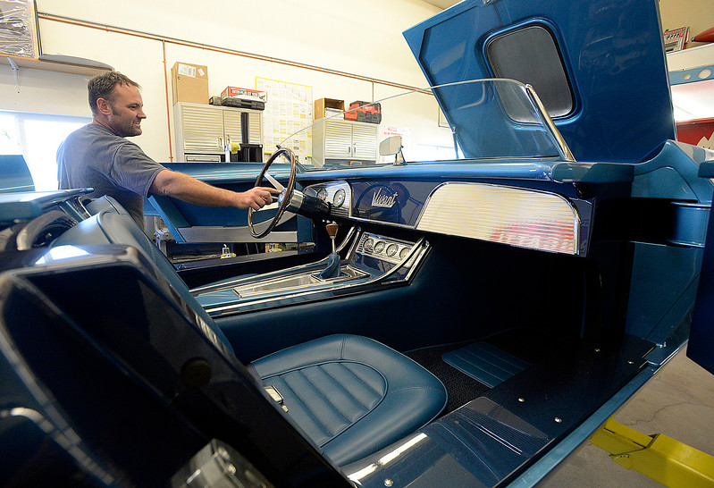 Jake Yenny points out some of the details on the inside of a 1965 Vivant on Wednesday, Oct. 18, 2017, at his Loveland shop. Yenny spent a year and a half totally remaking a 1965 Vivant, a one-of-a-kind concept car that was created by a man who went on to spend his career designing things for Pontiac. The rebuilt Vivant won first place in its class this summer at the Pebble Beach Concours d'Elegance, which is considered the top car show in the world.   (Photo by Jenny Sparks/Loveland Reporter-Herald)