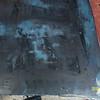 Trunlk lid deck shows lighter blue (original color?)  under the dark blue.