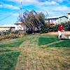 Barbara mowing the folks lawn in Omaha, NE, October 1969