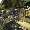 Dashboard out.  Large black object in foreground is the fuel tank, removed from its location behind rear seat.