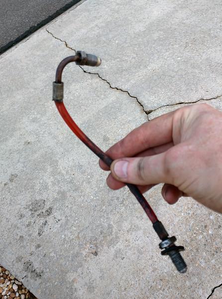 Original clutch master cylinder hose.