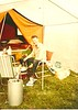 John Potter in front of his home made trailer tent. The kit was bought from the Daily Mirror and he made it in his father's garage. It was his office / sleeping quarters.